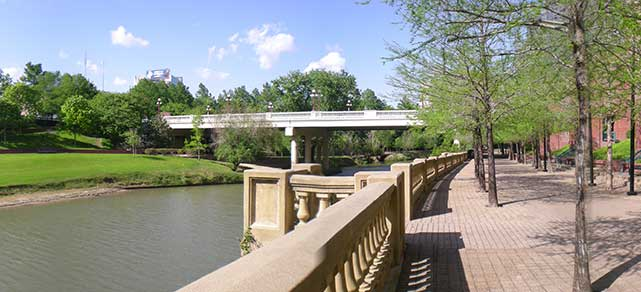 Buffalo Bayou traversing through Sesquicentennial Park in Downtown Houston. Photo by Brian Reading